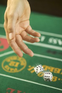 Rolling Dice at Craps Table --- Image by © Royalty-Free/Corbis